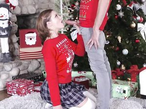 Christmas Sweater And Miniskirt On This Cute Slut